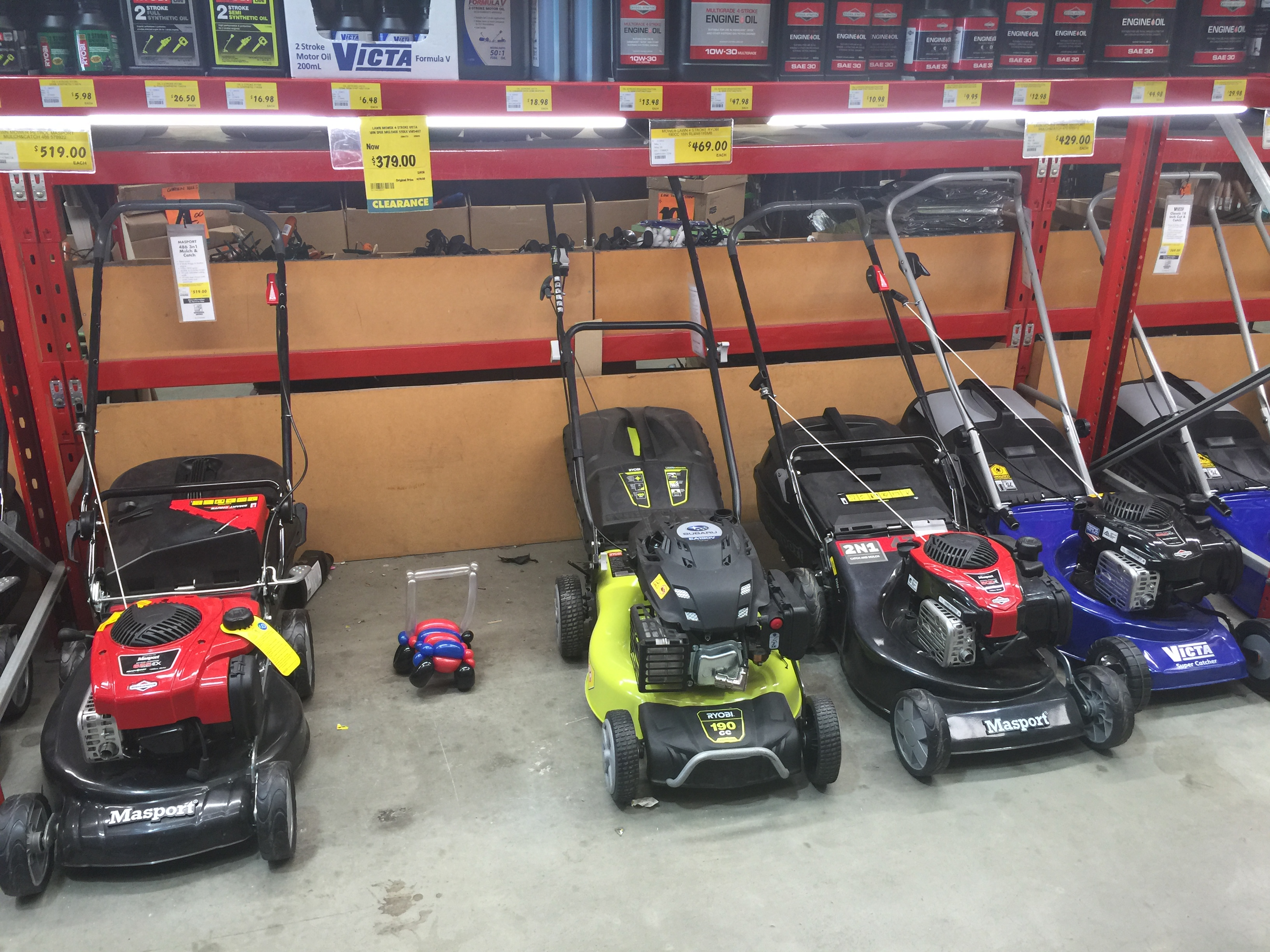 A 'new' mower hiding amongst traditional lawn mowers at Bunnings Morayfield © GreenSocks