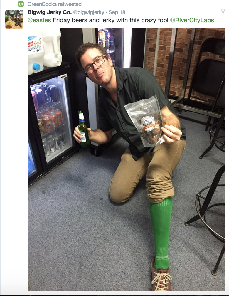 Richard Eastes with beer and jerky - in green socks - at RCL's Open House (Image credit: @bigwigjerky)