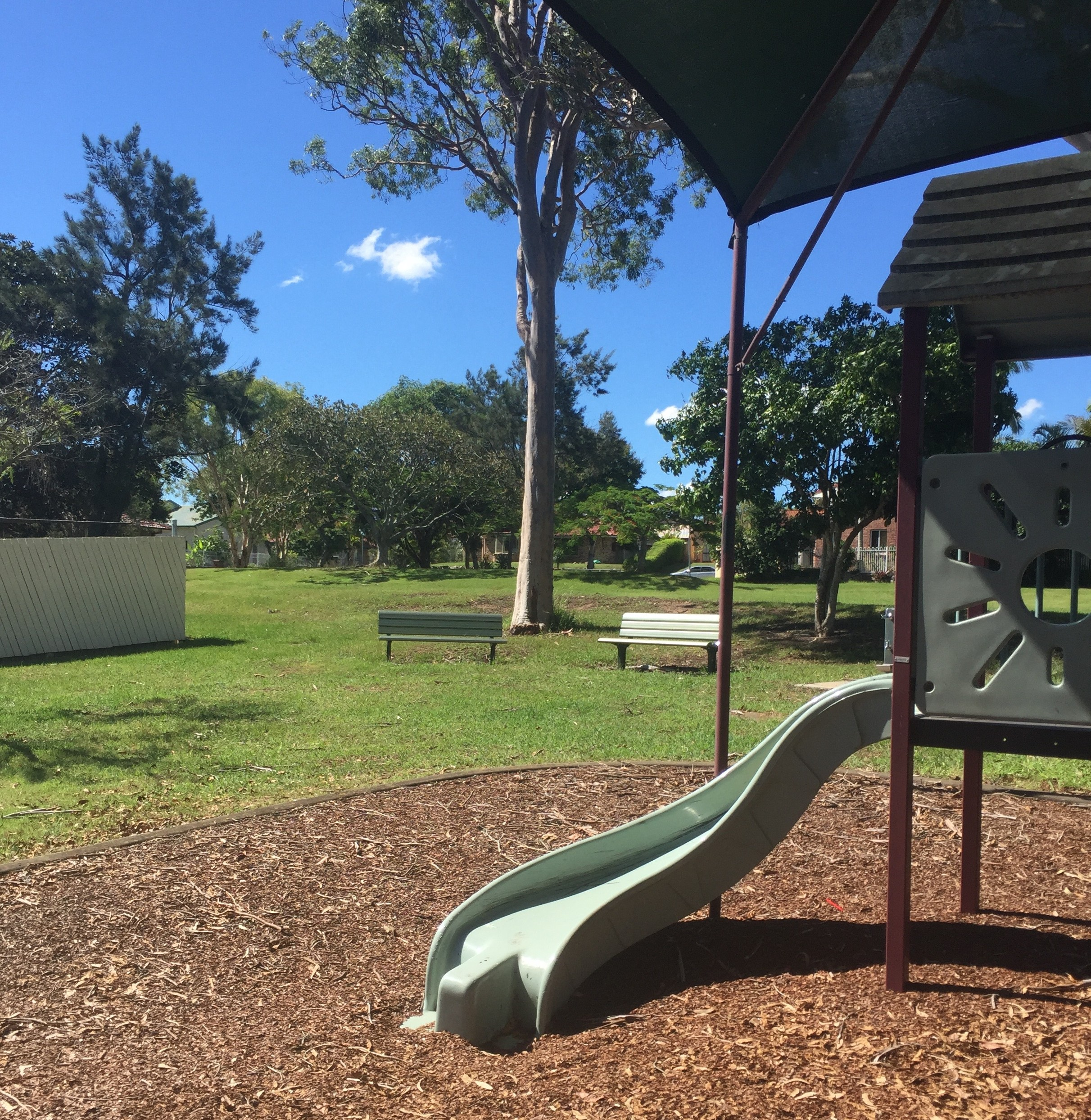 Relax on the green lawn while your children play in this Bracken Ridge playground © GreenSocks