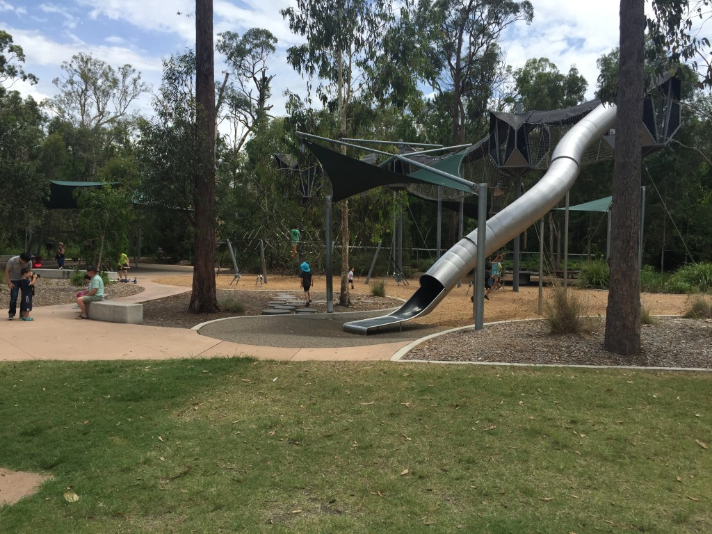Green grass to rest on after playing on the slides at the Calamvale District Park, Brisbane © GreenSocks