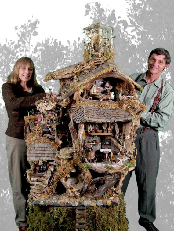 The Fairy Garden Treehouse with its builders, Debbie and Mike Schramer.