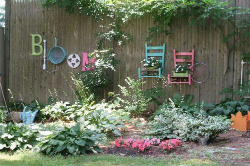 Bloom artwork by Jen Bowles on her garden fence